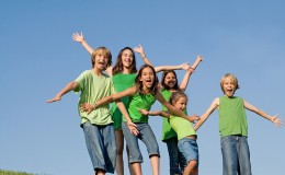 happy group of kids at summer camp singing or shouting,